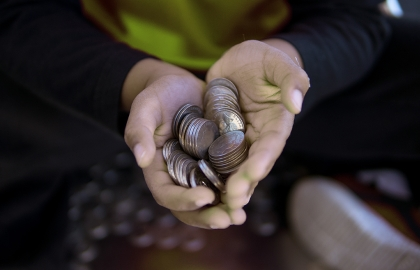 Cupped hands holding a pile of 10 cent coins